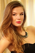 Ukrainian girl Aliona,21 years old with grey eyes and light brown hair.