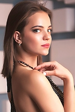 Ukrainian girl Alina,21 years old with green eyes and dark brown hair.