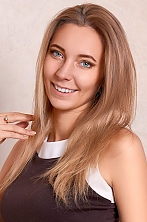 Ukrainian girl Tatiana,23 years old with green eyes and light brown hair.