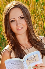 Ukrainian girl Snezhana,23 years old with brown eyes and light brown hair.