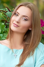 Ukrainian girl Elena,22 years old with green eyes and light brown hair.