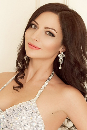 Ukrainian girl Alevtina,28 years old with brown eyes and black hair.