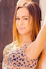 Ukrainian girl Yuliya,20 years old with brown eyes and light brown hair.