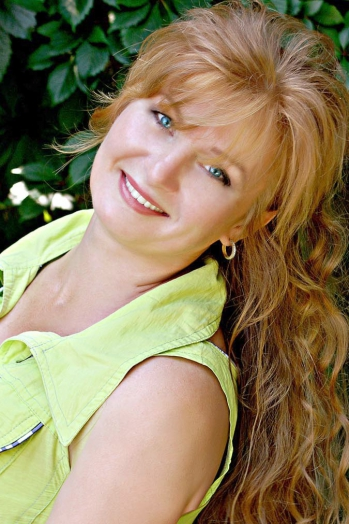 Russian girl Elena,49 years old with blue eyes and auburn hair.