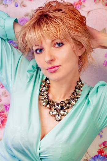 Ukrainian girl Anastasia,34 years old with green eyes and blonde hair.