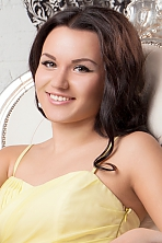 Ukrainian girl Elizaveta,21 years old with green eyes and dark brown hair.