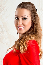 Ukrainian girl Olesya,30 years old with green eyes and light brown hair.
