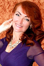 Ukrainian girl Lidiya,46 years old with blue eyes and red hair.