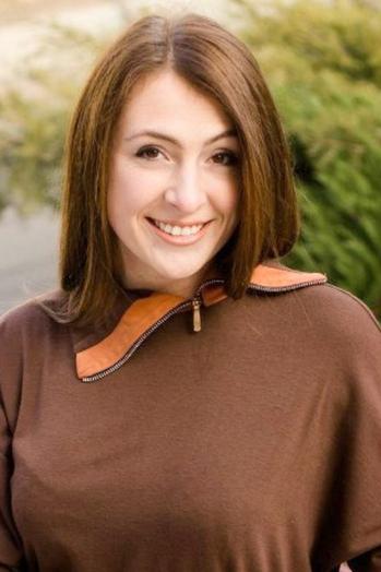 Ukrainian girl Anna,23 years old with hazel eyes and dark brown hair.