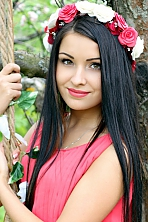 Ukrainian girl Olya,24 years old with brown eyes and dark brown hair.
