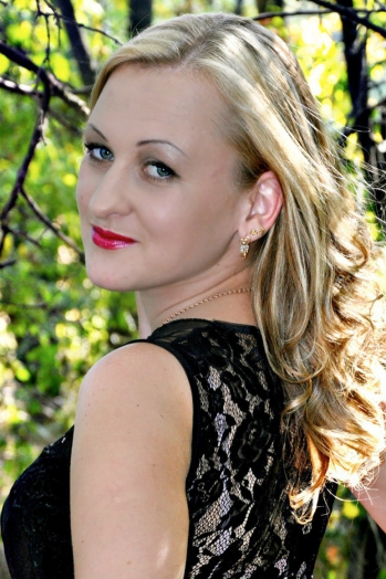 Ukrainian girl Julia,26 years old with blue eyes and blonde hair.