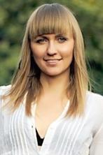 Ukrainian girl Larisa,35 years old with grey eyes and blonde hair.