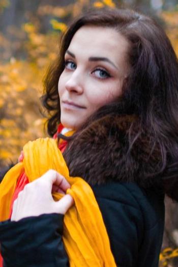 Ukrainian girl Galina,24 years old with blue eyes and black hair.