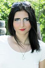 Ukrainian girl Marina,21 years old with blue eyes and black hair.