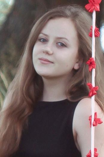 Ukrainian girl Inna,20 years old with green eyes and dark brown hair.