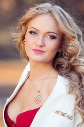 Ukrainian girl Anna,26 years old with blue eyes and blonde hair.