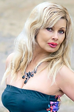 Ukrainian girl Olga,50 years old with green eyes and auburn hair.