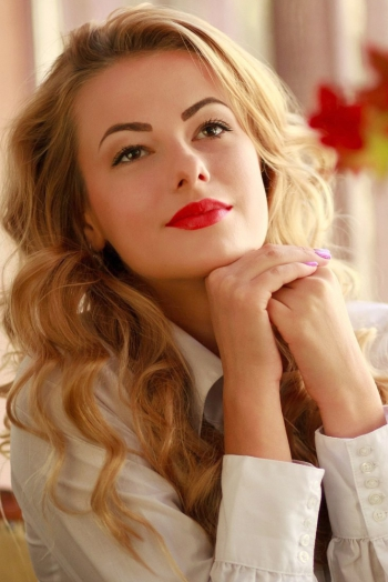 Ukrainian girl Irena,23 years old with brown eyes and blonde hair.