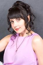 Ukrainian girl Elena,41 years old with brown eyes and dark brown hair.
