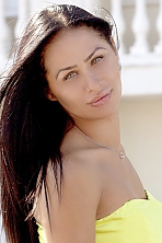Ukrainian girl Liliya,29 years old with green eyes and black hair.