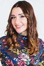 Ukrainian girl Olesia,24 years old with brown eyes and dark brown hair.
