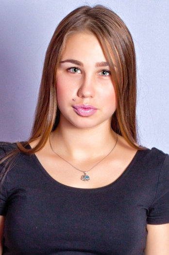 Ukrainian girl Daria,19 years old with green eyes and light brown hair.