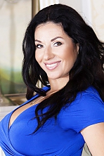 Ukrainian girl Nadejda,47 years old with brown eyes and dark brown hair.