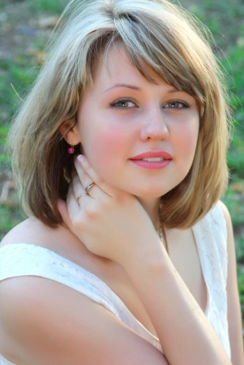 Ukrainian girl Alena,25 years old with blue eyes and blonde hair.