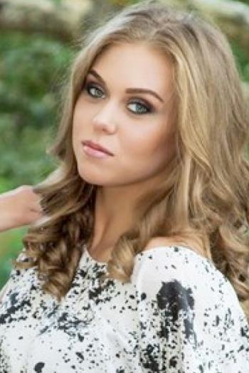 Ukrainian girl Anastasia,22 years old with grey eyes and light brown hair.