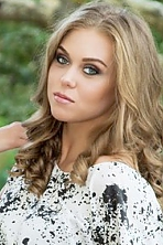 Ukrainian girl Anastasia,23 years old with grey eyes and light brown hair.