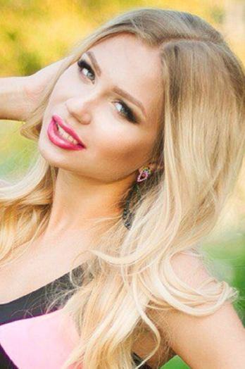 Ukrainian girl Evgenia,25 years old with green eyes and blonde hair.