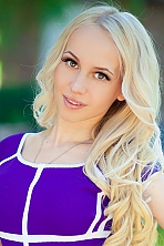 Ukrainian girl Alena,27 years old with brown eyes and blonde hair.