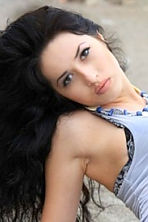 Ukrainian girl Kristina,27 years old with brown eyes and dark brown hair.