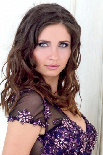 Ukrainian girl Anna,22 years old with green eyes and dark brown hair.
