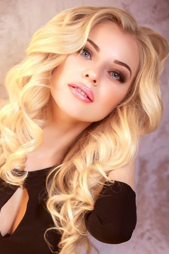 Ukrainian girl Alina,26 years old with blue eyes and blonde hair.