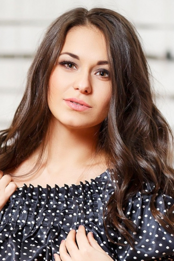 Ukrainian girl Angelika,30 years old with brown eyes and dark brown hair.
