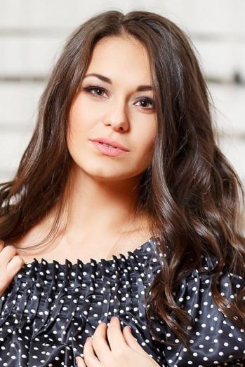 Ukrainian girl Angelika,29 years old with brown eyes and dark brown hair.