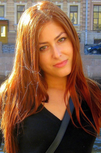 Russian girl Anastasia,27 years old with green eyes and red hair.
