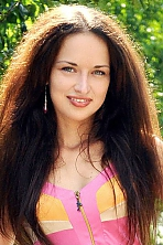 Ukrainian girl Anna,27 years old with green eyes and dark brown hair.