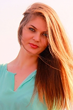 Russian girl Innessa,29 years old with green eyes and light brown hair.