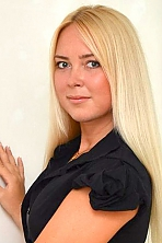Ukrainian girl Nataly,30 years old with blue eyes and blonde hair.
