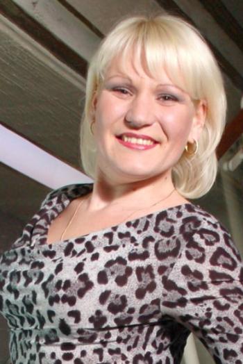 Ukrainian girl Anastasia,30 years old with green eyes and blonde hair.