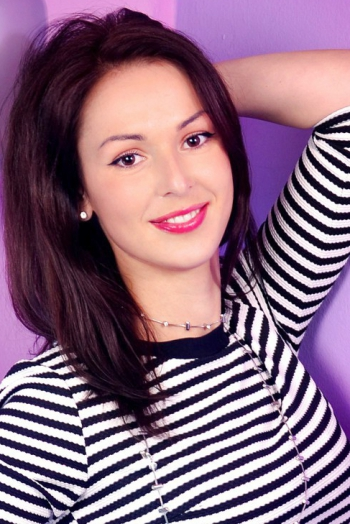 Ukrainian girl Natali,35 years old with brown eyes and black hair.