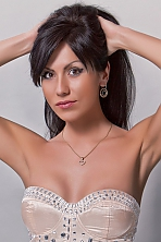 Ukrainian girl Vikki,31 years old with brown eyes and black hair.