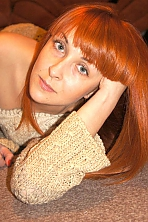 Ukrainian girl Miroslava,36 years old with grey eyes and red hair.