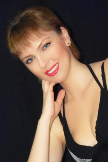 Ukrainian girl Oksana,41 years old with blue eyes and blonde hair.