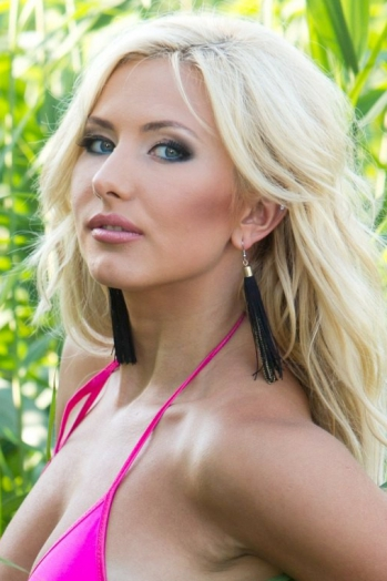 Ukrainian girl Aliona,25 years old with blue eyes and blonde hair.