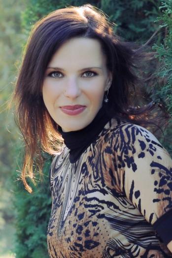 Ukrainian girl Olga,36 years old with green eyes and dark brown hair.