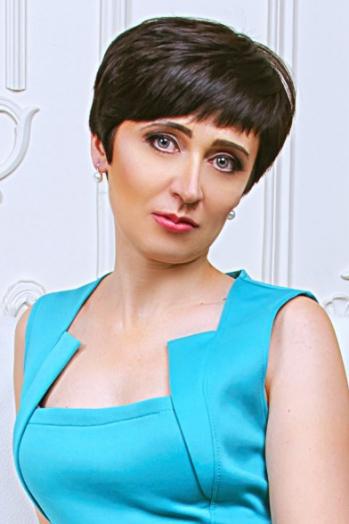 Ukrainian girl Nataly,41 years old with grey eyes and dark brown hair.