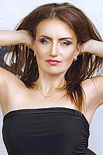 Ukrainian girl Elena,41 years old with green eyes and light brown hair.